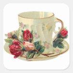 Taza de té del vintage y pegatina de los rosas