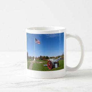 Taza del cañón y de café de la bandera americana