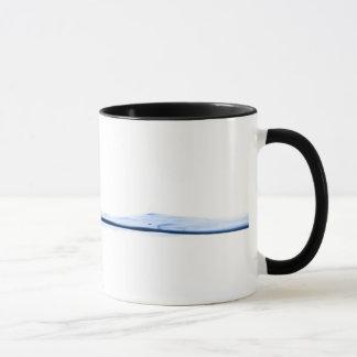 Taza del chapoteo del agua