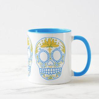Taza del cráneo del azúcar (azul/amarillo)