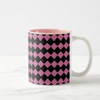 Taza del diamante rosado y negro