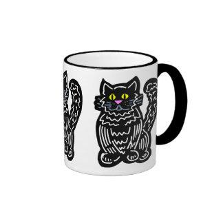 Taza del diseño del gato negro