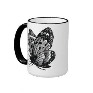 Taza del estilo del vintage de la mariposa