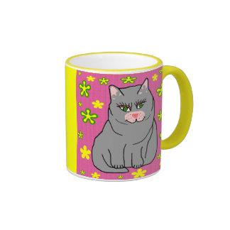 Taza del gatito de la flor