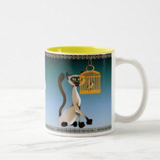 Taza del gatito y del pájaro