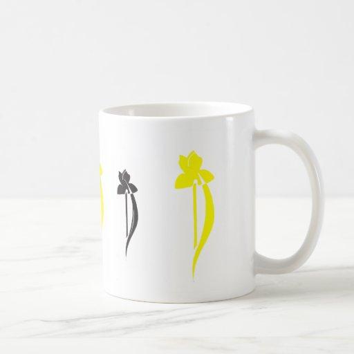 Taza del iris negro y amarillo