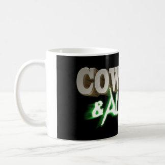 Taza del logotipo de los vaqueros y de los extranj