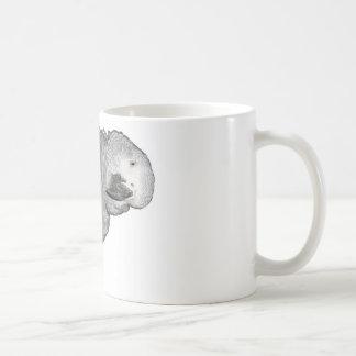 Taza del loro de Ollie del gris africano