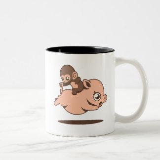 Taza del mono del bebé (que va al revés en un cerd