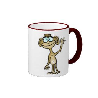 Taza del mono que agita