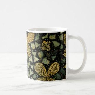 Taza del mosaico de la flor
