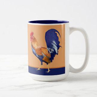 Taza del naranja del gallo