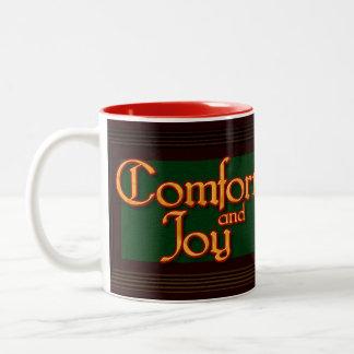 Taza del navidad de la comodidad y de la alegría