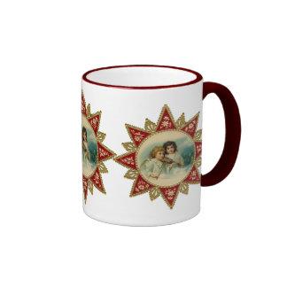 Taza del navidad de los ángeles del Victorian