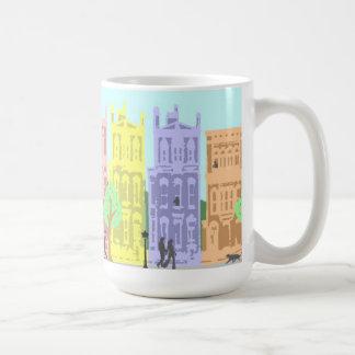 taza del pastel de la vida de ciudad