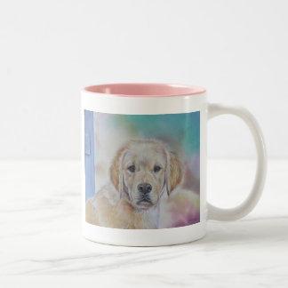 Taza del perrito del golden retriever