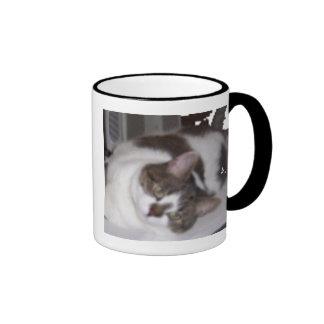 Taza del pisapapeles del gatito