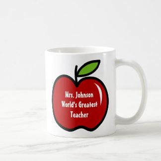 Taza del profesor con diseño rojo de la manzana el