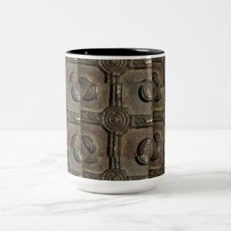 Taza del símbolo de Adinkra del metal de AfriMex U