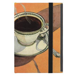 Taza del vintage de café, platillo, cuchara con la iPad mini funda