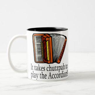 Taza divertida del acordeón