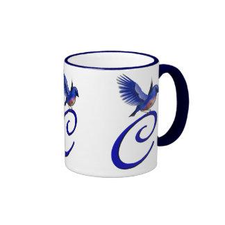 Taza elegante con monograma del Bluebird de la ini