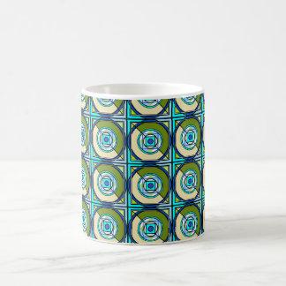 Taza en turquesa abstracta y verdes del diseño del