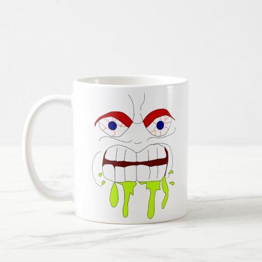 Taza enojada enojada de la cara