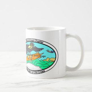 Taza esmeralda del logotipo de AOC de la costa