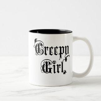 Taza espeluznante del chica