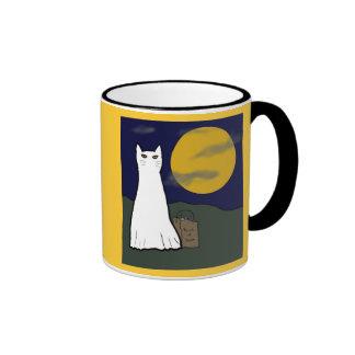 Taza fantasmagórica del gatito del truco o de la i