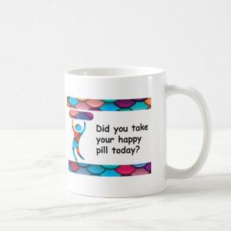 Taza feliz de la píldora