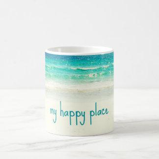 Taza feliz del lugar de la playa
