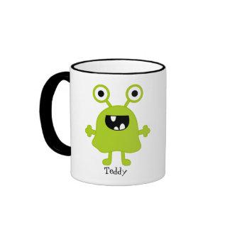 Taza feliz del monstruo del verde Googly divertido