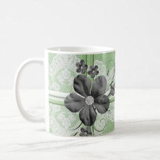Taza floral de la arpillera del cordón verde de
