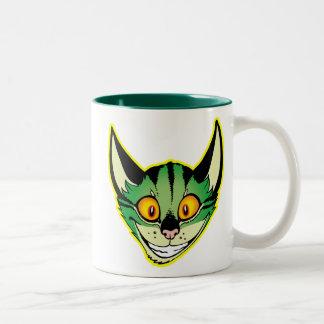 Taza fluorescente del gato del dibujo animado