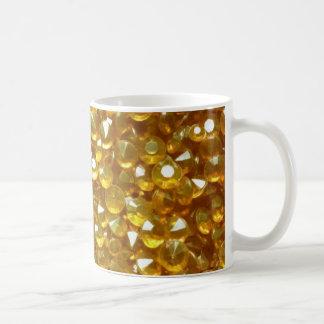 Taza gloriosamente de oro del té del café de los