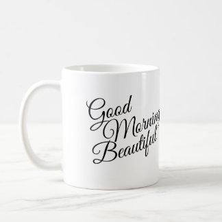 Taza hermosa negra y blanca de la buena mañana