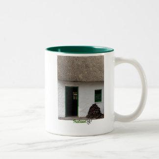Taza irlandesa verde de la cabaña - Irlanda