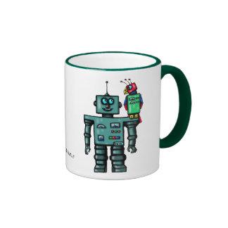 Taza linda divertida del arte del robot y del loro