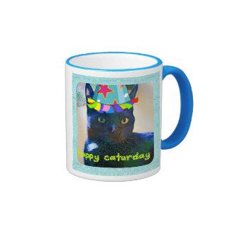 Taza linda feliz del gato negro de Caturday