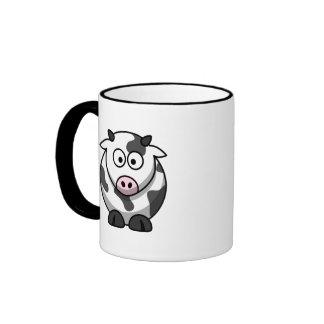 Taza linda zurda de la vaca