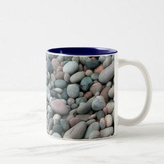 Taza lisa de las piedras