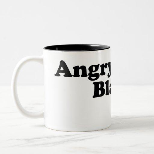 Taza negra enojada