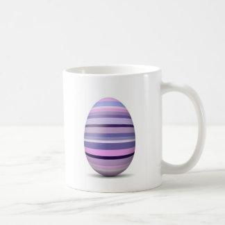 Taza púrpura del huevo de Pascua