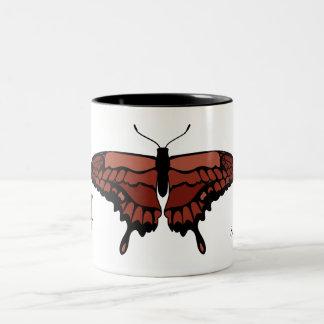 Taza roja de la mariposa