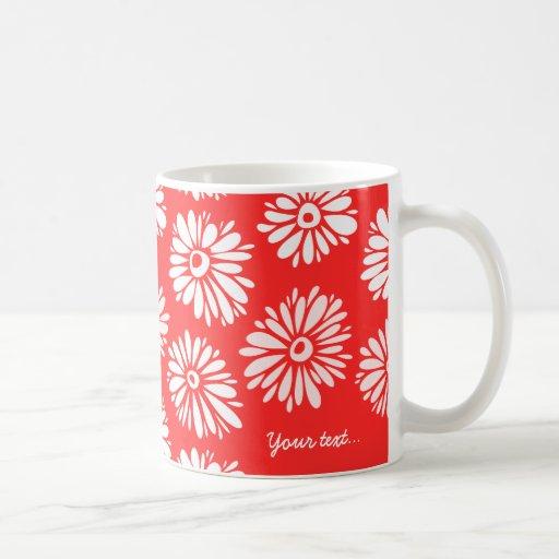 Taza roja de las flores