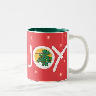 Taza roja del navidad de la ALEGRÍA