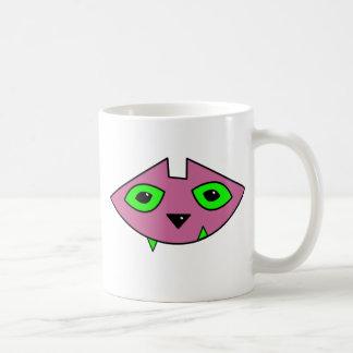 Taza rosada de la cabeza del gato
