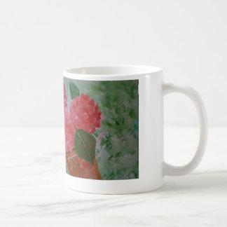 Taza rosada de las flores